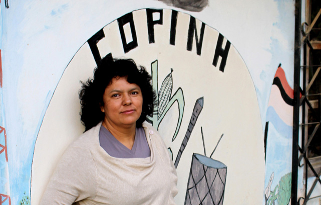 Berta Caceres stands at the COPINH (the Council of Popular and Indigenous Organizations of Honduras) offices in La Esperanza, Intibucá, Honduras where she, COPINH have organized a two year campaign to halt construction on the Agua Zarca Hydroelectric project, that poses grave threats to Rio Blanco regional environment, river and indigenous Lenca people.